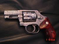 "Smith & Wesson 60-14,357 mag,2.125"" barrel,fully deep hand engraved & polished by Flannery engraving,rosewood grips,never fired,box & papers-awesome showpiece !!"