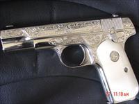 Colt 1903 32 cal. master hand engraved by S.Leis,& fully refinished in bright nickel with bonded ivory grips,hammerless,grip safety,with  certificate,made in 1920-awesome work of art