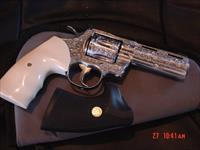 "Colt Python 4"" Stainless, fully deep hand engraved & polished by Flannery Engraving, bonded Ivory grips,certificate,357 mag.around 1987,awesome work of art !!"