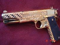 "Colt Government 45acp,5"",fully 24K gold plated,master deep scale engraved by Seattle Engraving Center,2 mags,box,papers,& never fired-a true work of art showpiece !! 1 of a kind !!"