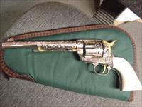"Colt SAA,125th Anniversary,2nd gen,,engraved by Brian Mears,polished nickel with gold accents,45 Colt,real ivory grips,7 1/2"" barrel,awesome one of a kind masterpiece !!"
