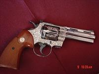 "Colt Python 4"",Master Engraved & refinished in bright nickel,by A.LoPrinzi,1972,so its now 44 years old. a true 1 of a kind work of art !!"