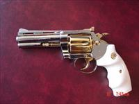 "Colt Diamondback 4"" fully refinished in bright mirror nickel with 24K gold accents,made in 1968,bonded ivory grips,50 years old ,38 special,awesome showpiece !!"