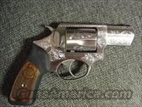 "Ruger SP101,357 Magnum,2 1/4"" barrel,deep factory scroll engraved,wood & rubber grips,satin stainless,in serial # box,manual lock,etc.super nice"