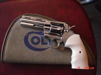 "Colt Python,4"",357,refinished nickel, custom wood grips & bonded ivory grips,Colt suede case, 1971, a true showpiece !!"