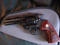 "Colt Python 4"",57 Magnum,blued,made in 1979,nice carved Rosewood grips,36 years old,action as smooth as butter,adj rear sight"