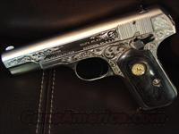 Colt 1903 Hammerless,32 auto,fully refinished in a satin nickel,& deep hand engraved by master engraver S.Leis with certificate,& custom grips,high gloss blued accents, made in 1916-a one of a kind showpiece !!