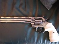 "Colt Python- Rare 8"" barrel,totally restored & refinished in bright high polished nickel,bonded ivory grips,blued accents,1981, & just finished in Oct-awesome showpiece."