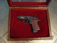 Walther PPK,75 Anniversary,engraved & gold accents,380acp,wood & glass Pres case,1 mag,all manuals etc,walnut grips,looks unfired