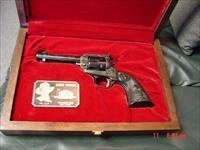Colt John Wayne The Duke Commemorative, New Frontier 22LR, Sterling Silver inlays,& Sterling plate in fitted wood case, unfired & brand new