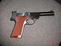 "High Standard Trophy Supermatic 22LR,5 1/2"",wood grips with thumb rest, 1 magazine,,adjustable rear site,new soft case"