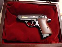 Walther PPK 75th Anniversary,engraved with gold accents,blued,wood grips,wood & glass pres case,rare model,380