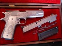 Colt Gold Cup National Match Series 70, nickel,deep relief master engraved by Clint Finley,45acp,with matching Colt Ace 22LR,engraved conversion kit,scrimshaw ivory grips,& custom heavy wood case-one of a kind package !! a work of art !!