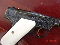 "Colt Woodsman 1st Edition,1928,Master engraved & blued by Clint Finley & signed, 6 1/2"",22LR,24k gold inlays,real ivory grips,a true work of art as usual. 1 of a kind !!"