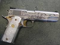 Colt Government 1911,Master engraved by Ken Smith of Florida,polished stainless slide,24K gold accents,Pearlite grips,Series 80,MKIV,a work of art & a 1 of a kind masterpiece !!