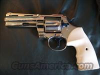 "Colt Python,4"" 357 mag,restored,& refinished nickel with fire blue accents & bonded ivory grips-nicer than new,made in 1977"