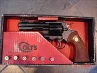 "Colt Python 4"",totally refinished in high gloss presentation grade blue,original box,circa 1967,wood grips,like a mirror"