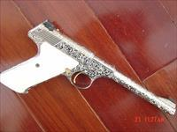 "Colt Woodsman fully deep master engraved ,& nickel plated,by Bob Valade,real carved ivory grips,around 1950,22lr,6"",more engraving than you can imagine-a real show stopper,work of art"