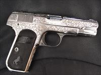 Colt 1908,fully master hand scroll engraved,& refinished in bright mirror nickel,380 auto,made in 1921. a work of art masterpiece !!
