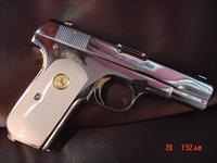 Colt 1903,hammerless,32 cal,fully refinished in bright mirror nickel with 24K gold accents,& bonded ivory grips,made in 1919 !! awesome showpiece !!
