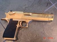 Magnum Research Desert Eagle,high polished 24K gold plated,50 caliber hand cannon,unfired in case with all papers-awesome showpiece