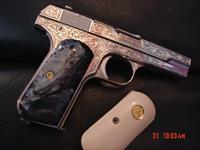 Colt 1903 hammerless,32cal,1918,master engraved by S.Leis & refinished in bright nickel,black Pearlite & bonded ivory grips, awesome work of art with certificate.