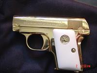 Colt 1908 Vest Pocket Hammerless,25 ACP,circa 1920,fully refinished in bright 24K gold,bonded ivory grips, awesome showpiece !!
