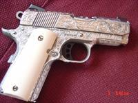"Colt Defender 3"",fully engraved & polished by Flannery Engraving,stainless & Cerakote, faux ivory grips & originals,new in box with papers.a one of a kind 45acp work of art !!"