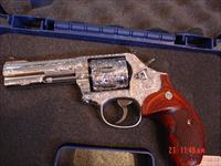 "Smith & Wesson 686-6,Fully engraved by Flannery,custom rosewood grips,& original grips,polished stainless,4"",357 Magnum,in box with all papers-awesome one of a kind showpiece !!"
