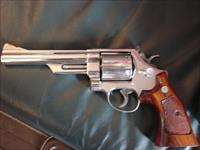 "Smith & Wesson 29-3,bright mirror nickel,6"",44 magnum,wood grips,& heavy glass & wood Pres case- made 1983"