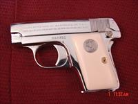 Colt 1908 Vest Pocket Hammerless,25 caliber,made in 1923,fully refinished in bright nickel,bonded ivory grips -done in Nov 2016