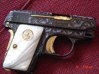 Colt 1908,25cal.,Vest pocket,fully engraved by Flannery Engraving,high gloss re-blued with gold accents,made in 1918,hammerless. a tiny work of art. !!
