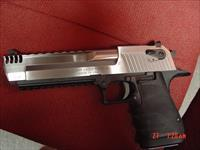 "Magnum Research Desert Eagle 50AE, solid stainless & alloy,with built on comp-very hard to find hand cannon,never fired,in case with all papers 6"" & DVD,MKXIX,awesome looking gun !!"