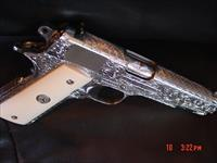 Colt Delta Elite 10mm,fully 100% deep hand engraved & polished by Flannery Engraving,bonded ivory grips,certificate,2 mags,box & manual & regular grips,1 of a kind work of art !!