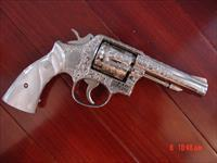 "Smith & Wesson Model 10-6,Fully engraved by Flannery Engraving,refinished in bright nickel,Pearlite grips,4"" barrel,38 Special,1970's,awesome one of a kind showpiece !!"