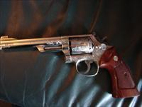 "Smith & Wesson model 19-4,deep master scroll engraved,bright nickel,6"",made in 1978,wood grips,original silver box,with manual & all papers-a work of art-super nice 357 magnum !"