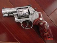 "Smith & Wesson 686-6 plus,7 shot,2 1/2"",fully deep hand engraved & polished by Flannery Engraving,Rosewood grips,certificate,box & manual-a real work of art 357 Mag."