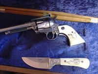 "Ruger New Model Blackhawk,engraved,scrimshaw grips,custom engraved knife with real Caribou antler grips,& scrimshaw,2 certificated,huge oak case,boxes & papers,357 mag,6 1/2"" barrel.one of a kind masterpiece set !!"