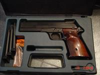 Beretta rare Model 89 Target pistol,with heavy barrel,22LR,adj.site,walnut grips,& 4-10 round magazines,extra front sites,original box,feels great in the hands !!