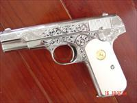 Colt 1903,32 caliber, 1915,engraved by S.Leis,refinished in bright nickel, certificate & bonded ivory grips-awesome work of art !!