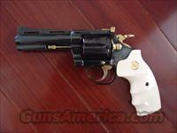 "Colt Diamondback,4"",refinished in high gloss blue with 24k Gold accent,bonded Ivory finger groove grips,made 1n 1969,38 special,& an awesome showpiece,& shooter"