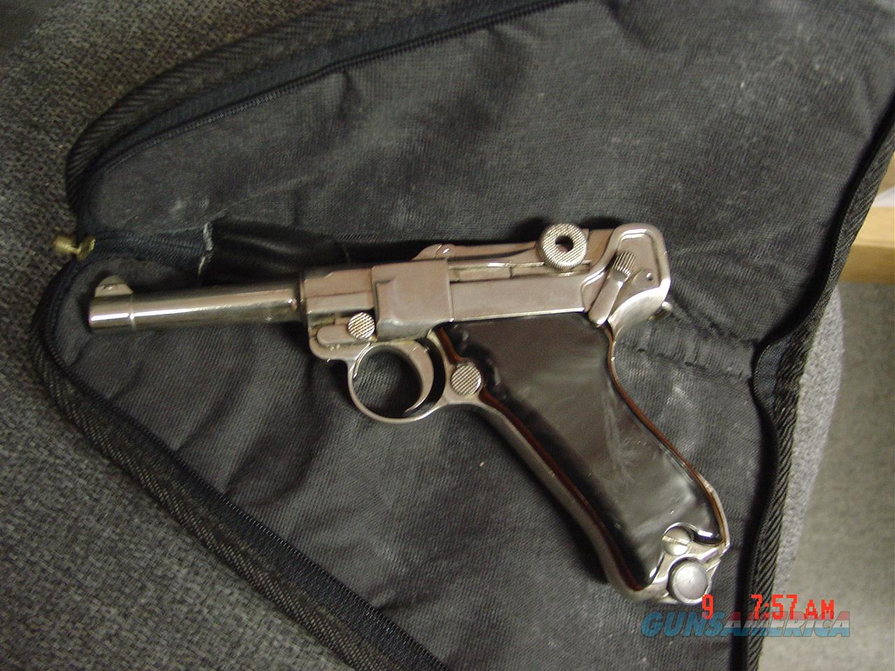 Luger- German 7 65 caliber older refinished nickel,custom black Pearlite  with wood grips,made around 1923 so I was told,1 magazine,
