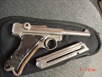 Luger- German 7.65 caliber older refinished nickel,custom black Pearlite with wood grips,made around 1923 so I was told,1 magazine,
