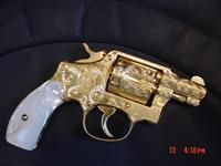 "Smith & Wesson Pre model 10,2"",38SPL,24K gold plated,fully engraved by Flannery Engraving,REAL Pearl grips, late 40's to early 50's, a 1 of a kind masterpiece !!"