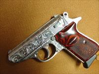 Walther PPK/S fully deep hand engraved by Flannery,polished stainless,Rosewood grips,380 auto,looks new,no box etc-but a one of a kind masterpiece !!