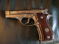 Beretta Model 84BB , 380 auto,nickel,wood grips,1-13 round magazine,double & single action,made in Italy,used but not abused !!