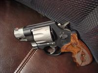 "Smith & Wesson model M327,8 shots,357 magnum,super light,Performance Center light trigger pull,beautiful wood grips,2"" barrel,2 tone finish,box & manual,as new,test fired-,super nice !!"