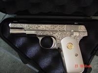 Colt 1908 380 auto,Master engraved by S.Leis of Florida,refinished nickel,bonded ivory grips,certificate,& made in 1915-awesome work of art-1 of a kind