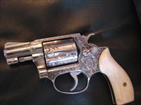 "Smith & Wesson Model 60 no dash,1970,master engraved in deep relief by Clint Finley of Redding Ca.,stag horn heart grips,that look like ivory, 1 3/4"" barrel,38 special,,polished stainless,a one of a kind work of art !!"