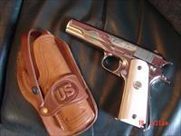 Colt Argentine Army,D.G.F.M.under license by Colt, & its the model 1927,fully refinished nickel,real Water Buffalo bone grips,carved holster,made around 1950,Lanyard loop,Colt 45 magazine-a real showpiece !!
